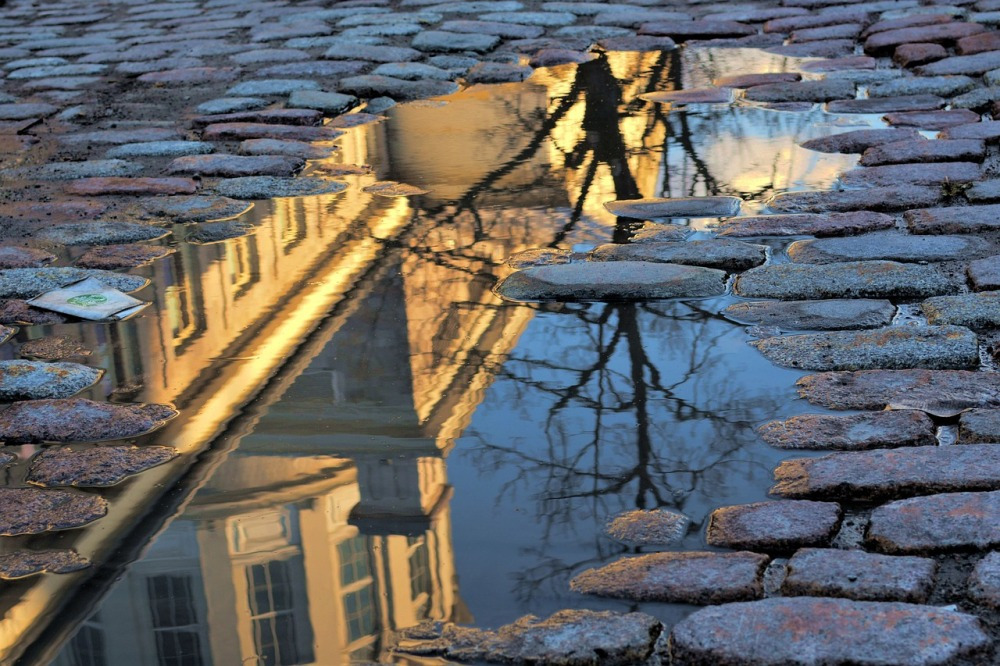 Montreal architecture reflected in puddle